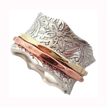 Etched silver ring with copper and gold spinners