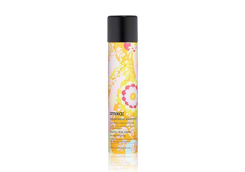 Image of orange bottle of amika hair spray with floral design