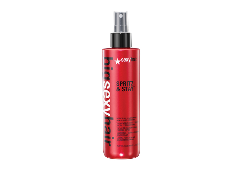 Image of red hair spray bottle with black cap