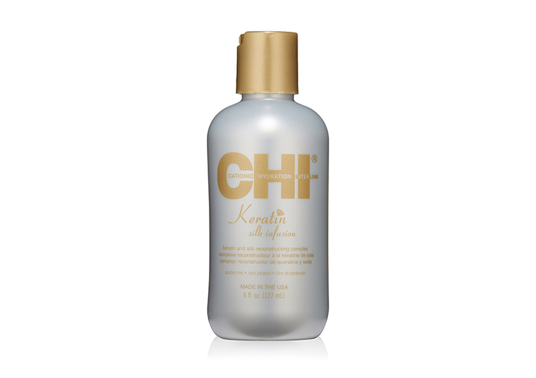 Silver bottle of CHI hair treatment with gold cap