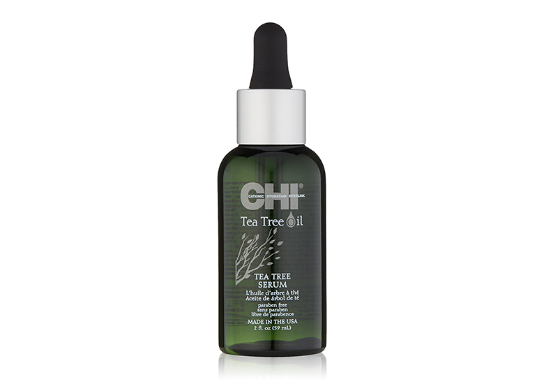 Green tinted bottle of CHI serum with tree design and black dropper top