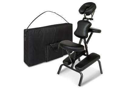 Black professional massage chair with large bag
