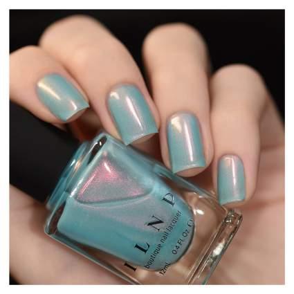 Hand with blue iridescent nail polish