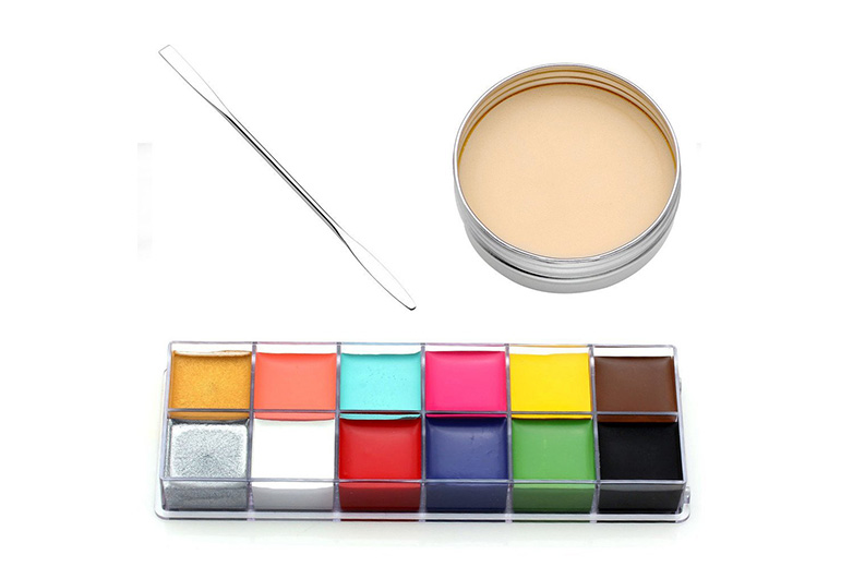 Brightly colored grease paint palette with fake flesh pot