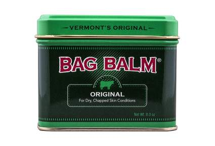 Green metal tub of bag balm