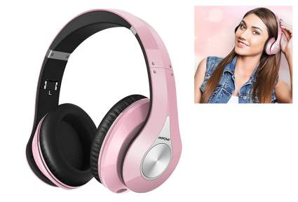 Light pink wireless headphones with picture of teen girl wearing them