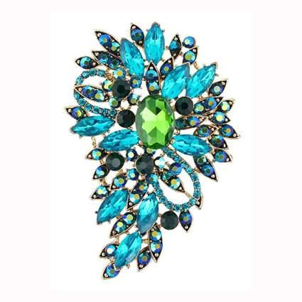 blue and green crystal swirl brooch