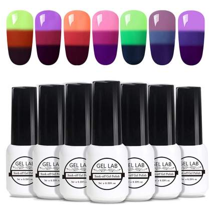White gel polish bottles with tri-color swatches