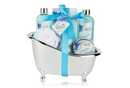 Spa gift basket in a mini bathtub with bubble bath and scrubs as valentines gift