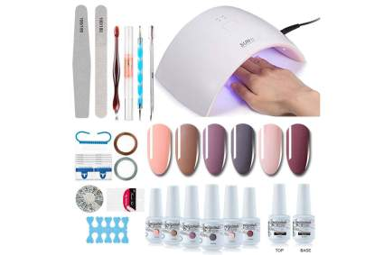 Gel nail polish set with tools and UV lamp