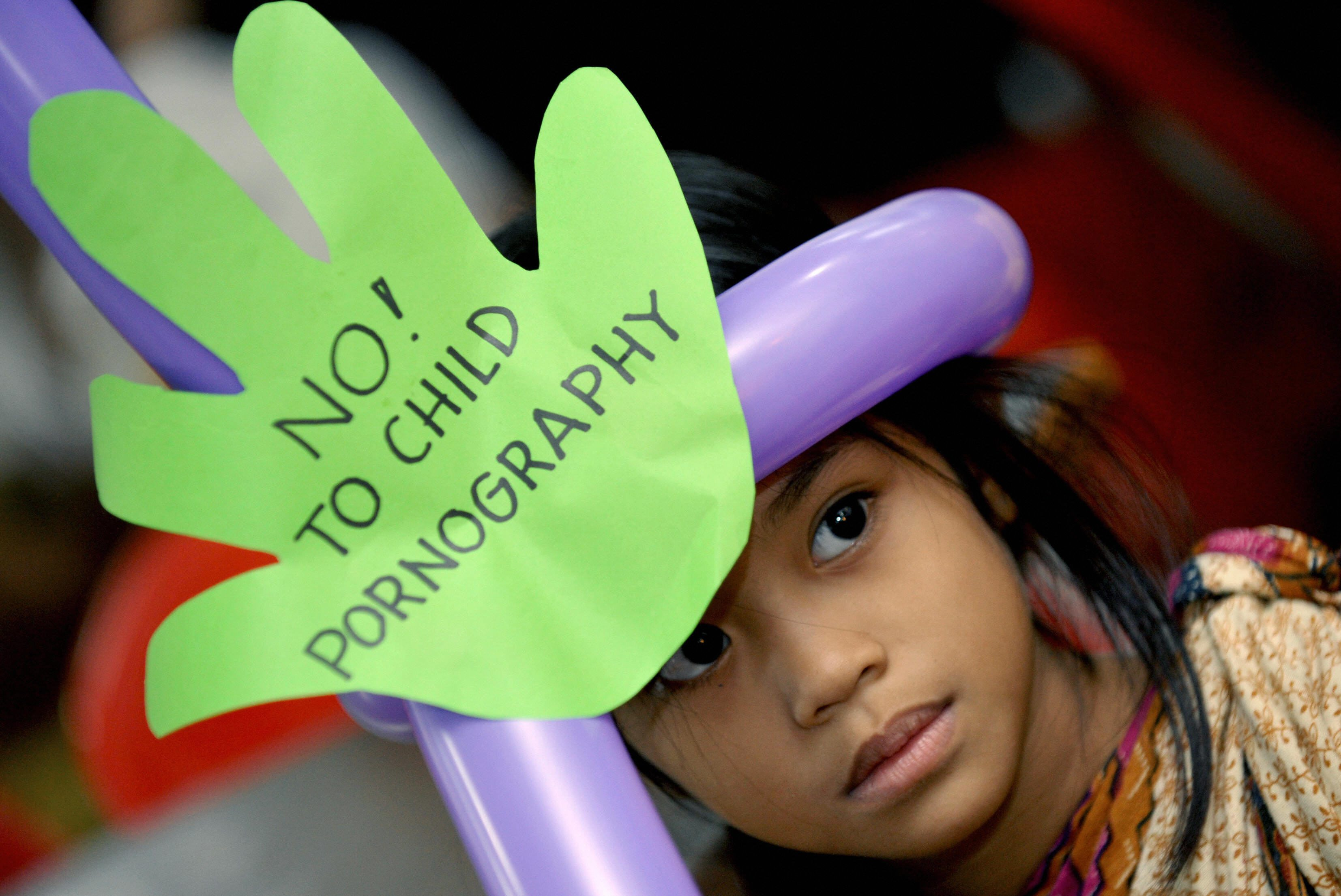 girl with sign - no to child pornography