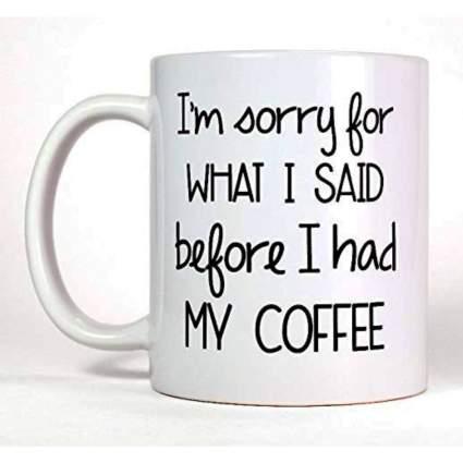 white ceramic I'm sorry coffee mug