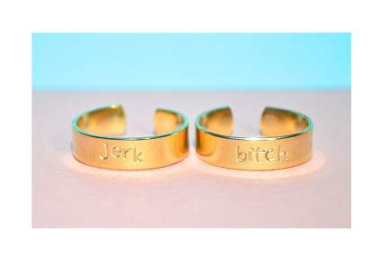 Two brass rings with offense pet names on them as a best friend Valentines gift