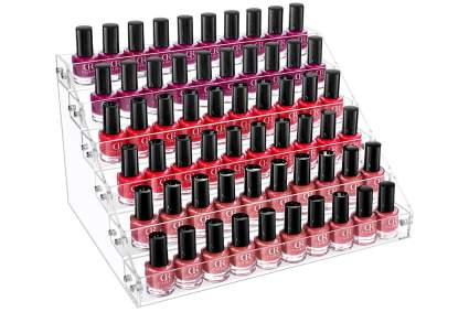 Tiered tabletop nail polish stand with polish bottles