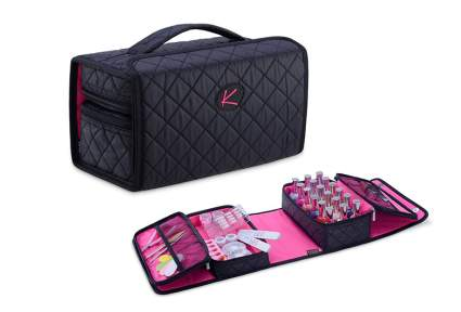 Black fabric case with pink inside and nail polish organizers