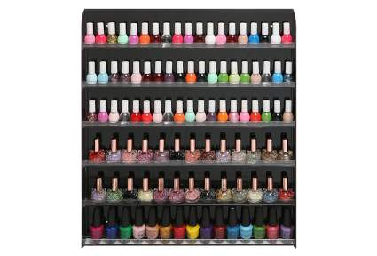 Image of black wall mounted nail polish rack with bottles