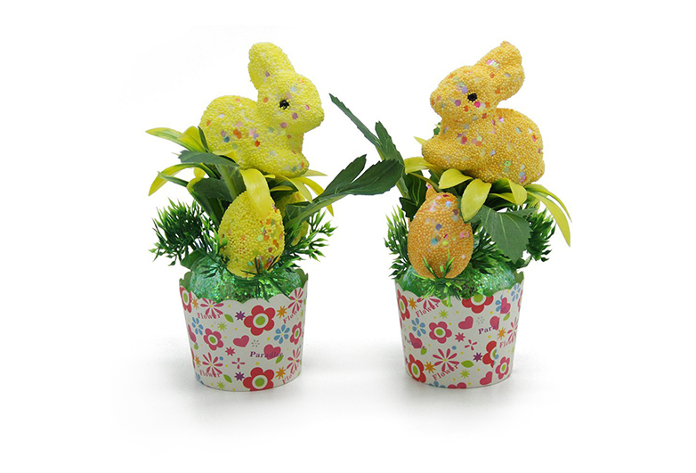 Two little yellow bunnies on pink cups with greenery, Easter centerpieces, cupcake easter tablescape