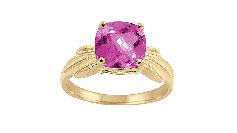 yellow gold ring with cushion cut pink topaz
