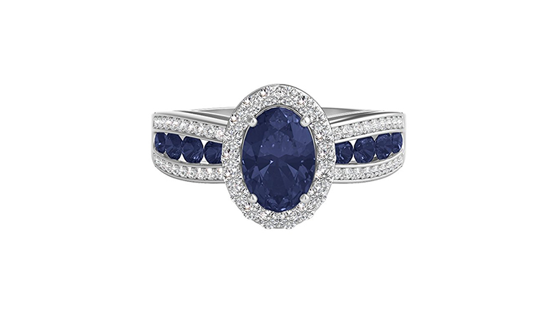 white gold halo set oval sapphire ring with diamond and sapphire shoulders
