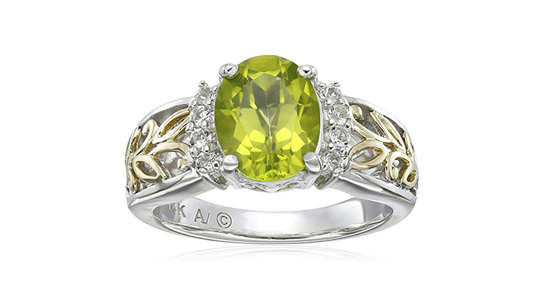 silver and gold oval peridot ring with white topaz accents