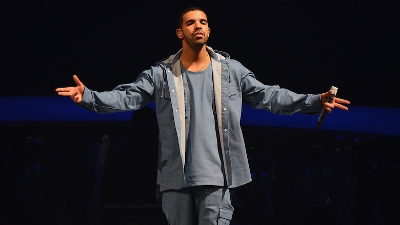 Drake performs at a concert.