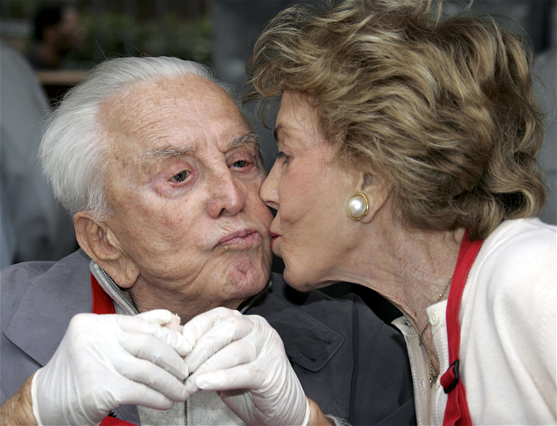 Kirk Douglas Kissing Wife Anne