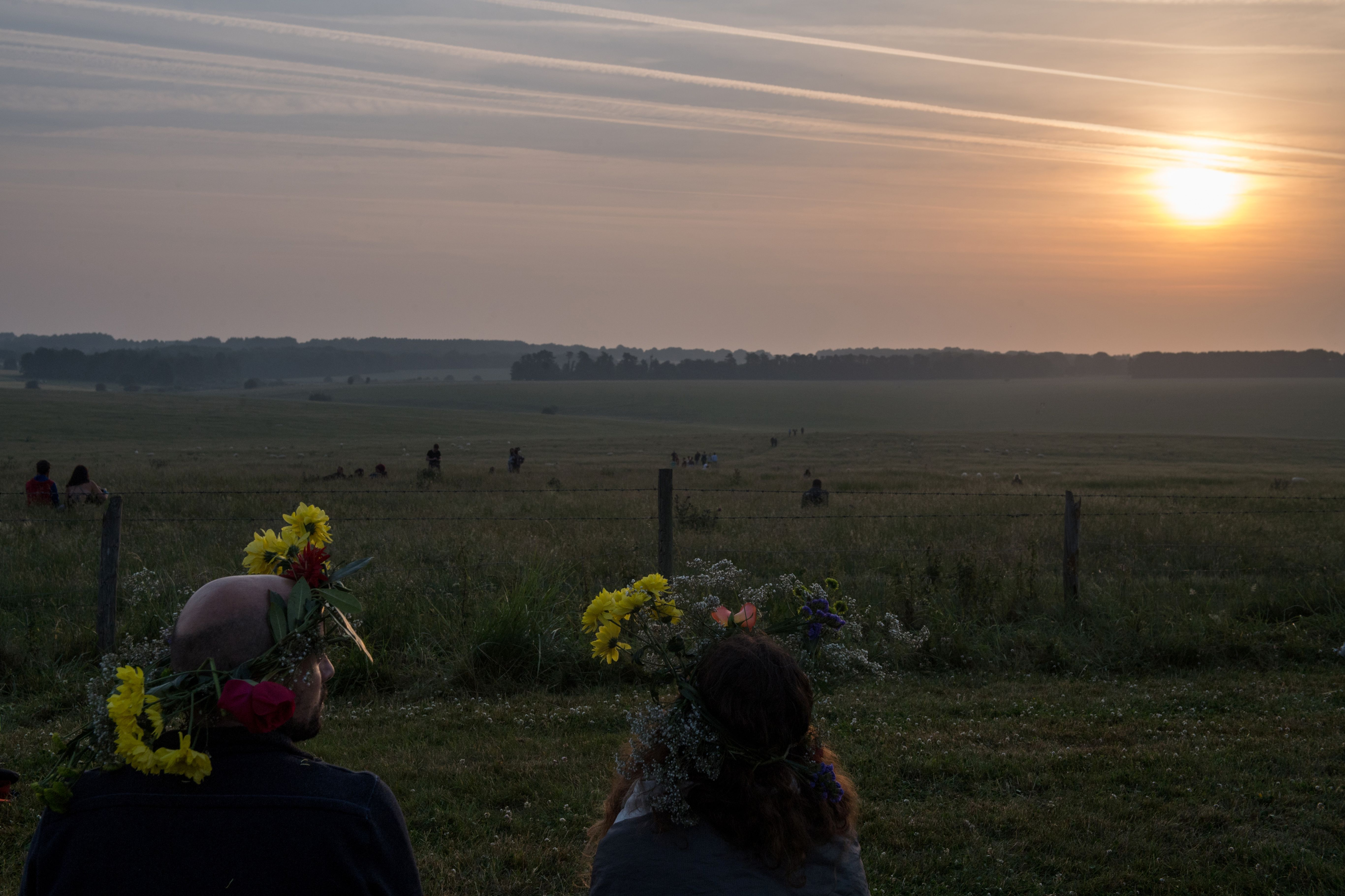 People with flowers in their hair watching sunrise