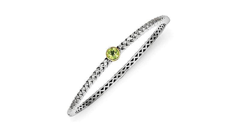 sterling silver bangle bracelet with 14k gold bezel set peridot