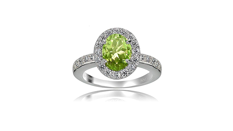 Sterling silver peridot ring with white topaz halo setting