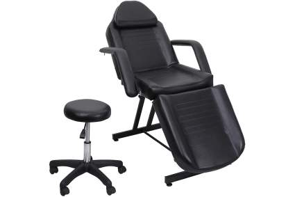 Black tattoo chair with stool