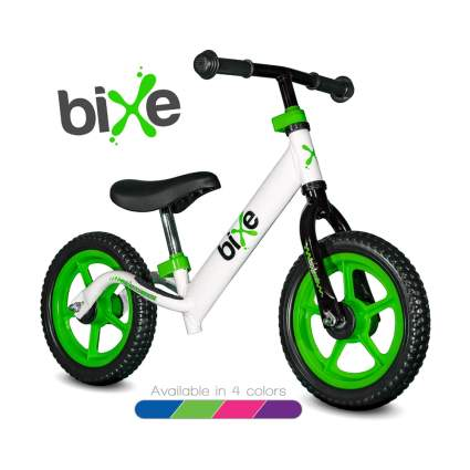 green and white balance bike