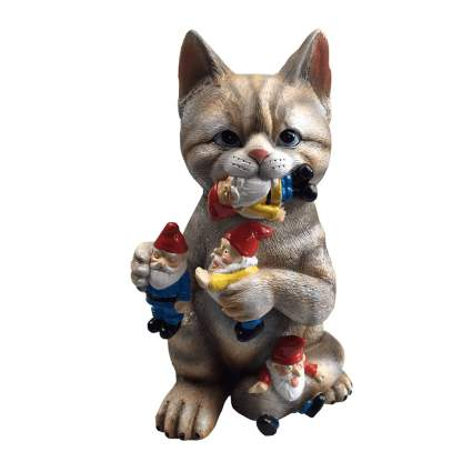 Figurine of cat eating lawn gnomes