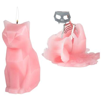 Pink candle with hidden cat skeleton