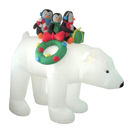 Blow up polar bear with penguins yard decoration