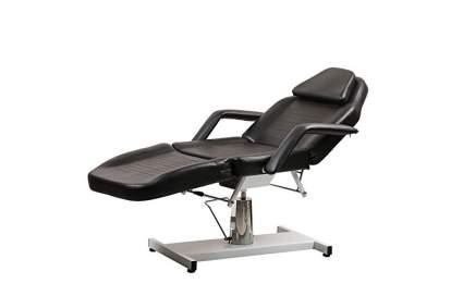 Black reclinging treatment chair