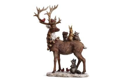 Deer statue with animals