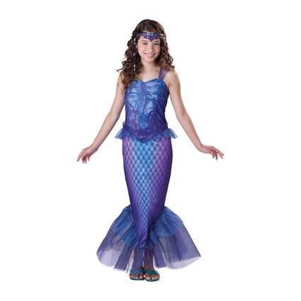 Young girl in irridescent mermaid dress