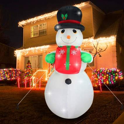 Inflatable snowman with present