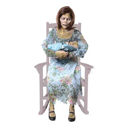 Mother in rocking chair with baby haunted house prop