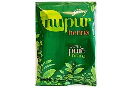 Green packet of henna