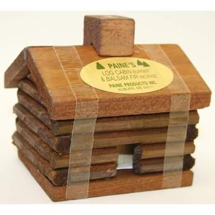 Tiny wooden cabin incense burner