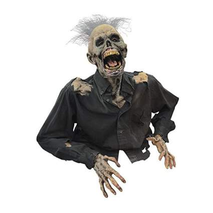 Haunted house prop of zombie rising from grave