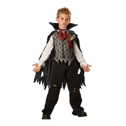 Young boy vampire with stake