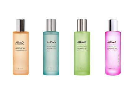 Four colorful frosted bottles of Ahava oil