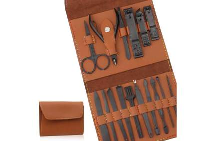Brown leather case with black manicure tools