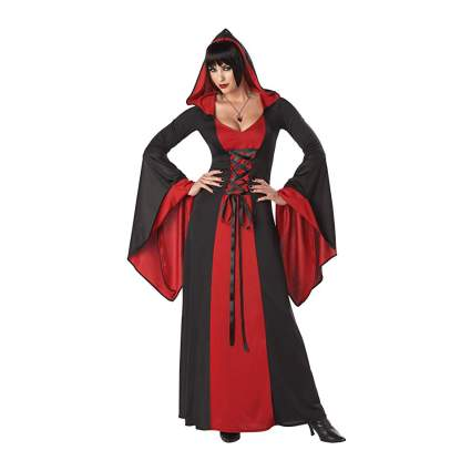 Woman in black and red hooded dress