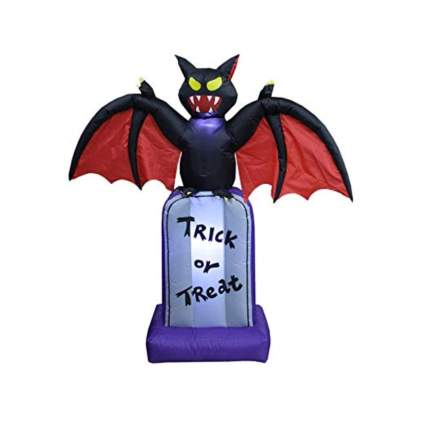 inflatable lighted black bat on a tombstone