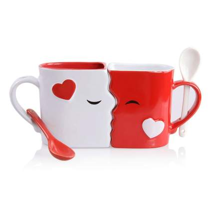 red and white kissing mugs