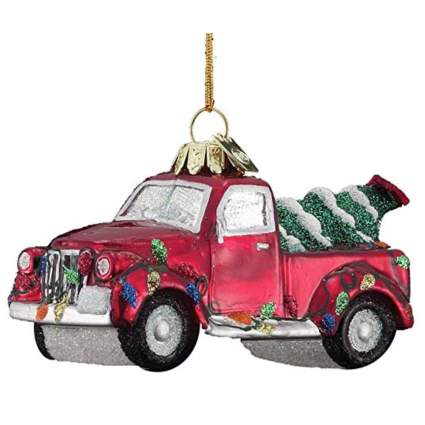 red farm truck with Christmas tree ornament