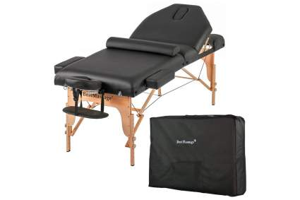 Black massage bed with carrying case and bolster